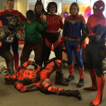 people dressed as superheroes for charity event