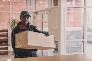 Crown Couriers delivering parcel
