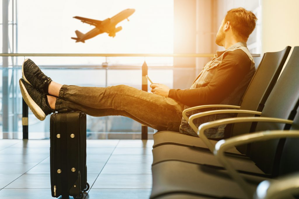 passenger waiting in airport as aviation services on rise